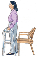 Woman using a walker to back up to chair.